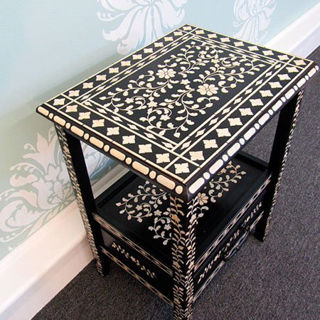 You can even add a stencil design to a plain, painted dining table. Paint a table flat black for maximum impact with an off-white or pale grey pattern.
