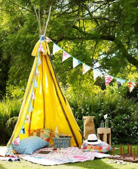Or opt for a more basic outdoor structure using tree branches or dowels and some colourful fabric to make a teepee. You can even use PVC pipes to make an outdoor teepee.