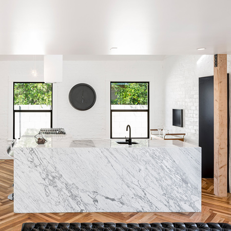 The renovation involved interior walls to be removed to increase light and space. The open plan living space on the lower level features a kitchen that takes centre stage
