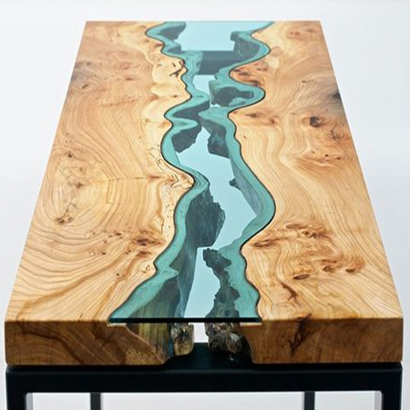It is hard to decide whether Greg Klassen's beautiful tables are furniture or art. Access to raw wood from a local sawmill allows Klassen to make use of its natural form and imperfections to craft his River Collection. These organic forms lend natural power to the 'rivers' and 'lakes' that form the basis for his design, all completed with coloured glass.