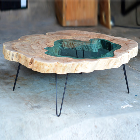The 'Pond Table', another Greg Klassen creation, is given life by working with rough wood slabs and a variety of different tools to bring the material to finished form. Greg Klassen's work is created with a mix of traditional hand tools and modern machines.