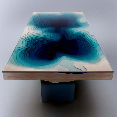 The designers took over a year to design the table, experimenting with sculpted glass, Plexiglas and wood until they created a design that represents a mesmerising abyss that first captured Duffy's imagination.