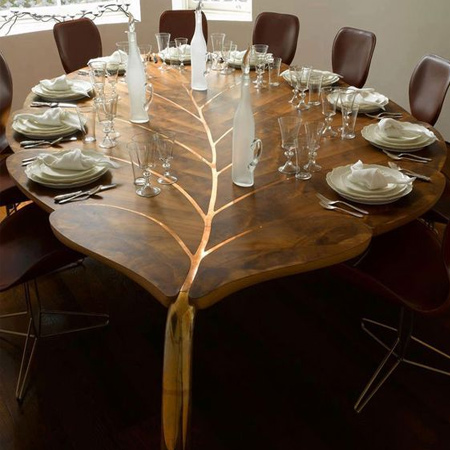 The 'Mulberry Table', by furniture designer John Makepeace, is one of a series of large 'leaf' tables in wood and polished bronze. All of the designs are rooted in a long-standing fascination with the properties of different timbers and the way technology and individual craftsmanship enable new possibilities.