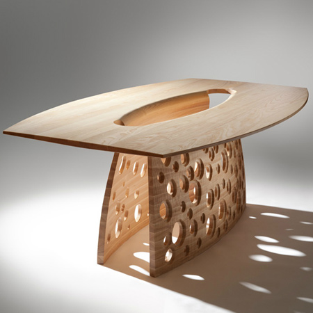 Another John Lee creation, the 'Salcombe Table' is made from solid ash and is a private commission. The inspiration for the design of the Salcome Table  came from eroded sedimentary rock and the effects of erosion. The underside and the outer face of the base have been textured and sandblasted.