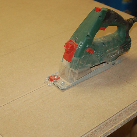 I used my Bosch PKS-16 to cut the sheet down into sections
