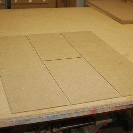 1. Lay the panels out in the formation as shown below. There is a long panel at either side, and two smaller panels in the centre.