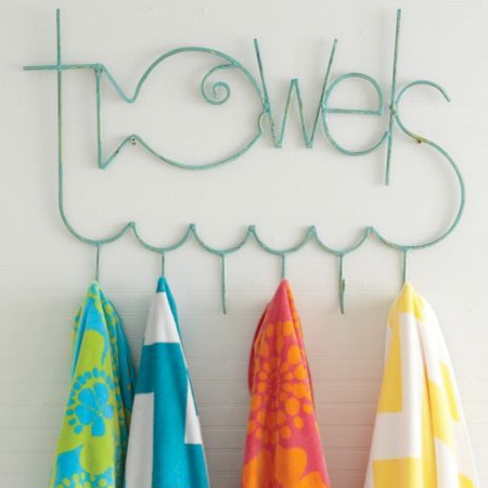 Rather than fitting towel rails, mount towel hooks to make it easier for children to hang up their towels