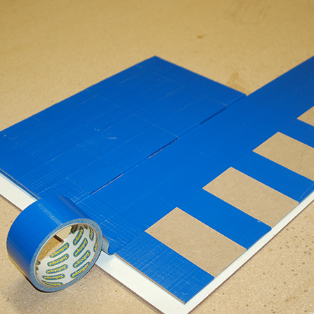 6. Wrap the side panel with strips of tape from top to bottom as per the centre panels.
