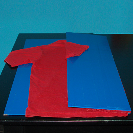 Fold over the right panel, open up and fold over the sleeve...