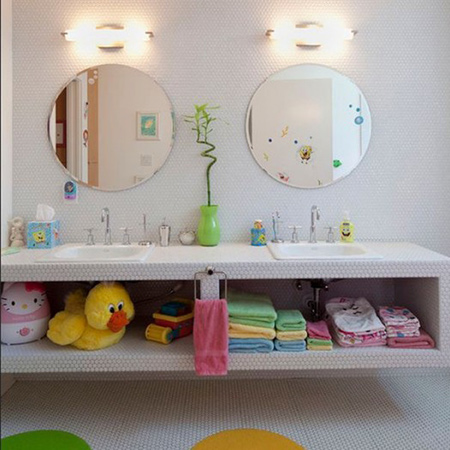 consider adding additional storage baskets and bins to reduce the clutter of bath toys and goodies