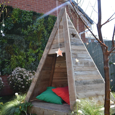 Practical for outdoor use once sanded smooth, reclaimed wood pallets are transformed into a wonderful outdoor tee pee play area for children