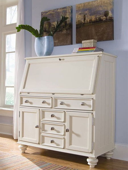 A secretary-style desk is a versatile piece and can work in a designated home office space as well as being ideal for a makeshift living room or basement office