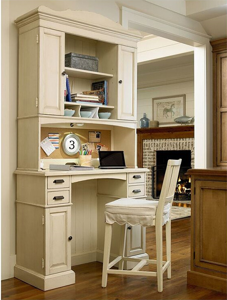 With cabinet space, shelving and a built-in corkboard, this all-in-one desk streamlines a cluttered office or even a chaotic kitchen into a manageable minefield
