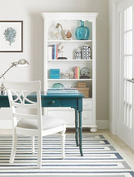 Baskets and bins in bright colors work well to accommodate office trinkets while open shelving provides room for displaying collectibles or travel treasures