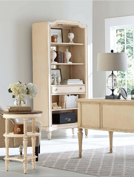 an oversized hutch provides room for displaying office ornaments like postcards, family photographs and storage bins