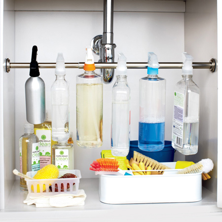 You can tidy up and organise this space using a chrome or PVC rod and brackets to hang spray bottles