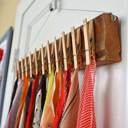 A scrap piece of wood, glue on some pegs, and you have an instant way to store your scarves.