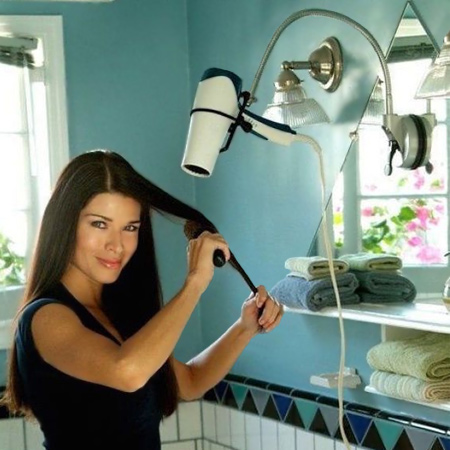 Take the ache out of drying your hair by re-purposing a flexible lamp into a hairdryer holder. Use epoxy adhesive to secure the lamp base onto a mirror or wall.