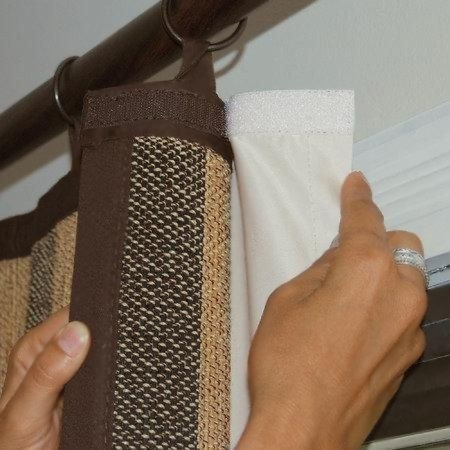 Warm up your home by adding backing to curtains, or if you work nightshift, you can make your own block out curtains. Use velcro tape to attach a layer of fabric to the back of existing curtains.