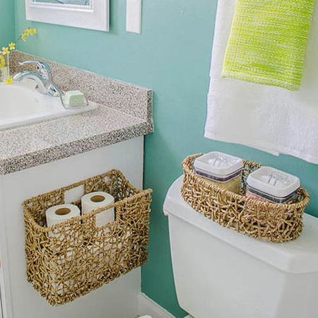 Baskets are perfect for coralling clutter, especially in a bathroom. Fasten them to cabinet sides, walls or even the back of a door.