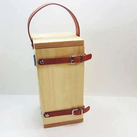 This is a plain pine box, but what adds character and makes it unique are the leather straps and added accessories. You can find leather and accessories at leather suppliers or larger fabric stores, or see if you have an old leather belt that you can repurpose.