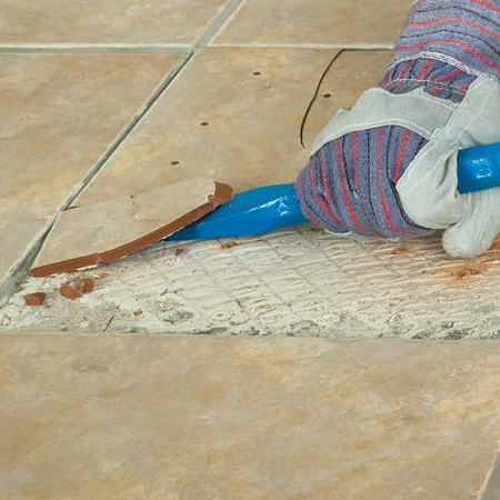 2. Using a drill / driver and HSS bit, drill a series of holes into the broken tile. Drilling holes will allow the broken tile to be easily  removed.