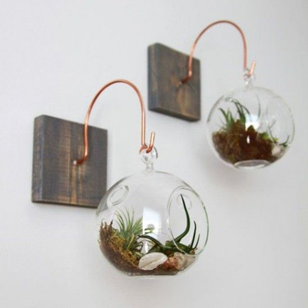 bend medium-gauge copper wire to hang glass plant holders