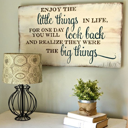 Use reclaimed wood, or even an old door, to add inspirational quotes to a plain wall.