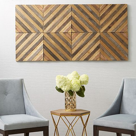 Thin boards of differing heights are glued together and mounted onto a feature wall in opposing directions to create a visually interesting display.