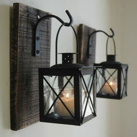 Scrap planks of rough cut timber fitted with steel brackets can be used to hang votive lanterns. Spray brackets and lanterns with Rust-Oleum High Temperature matt finish spray paint.