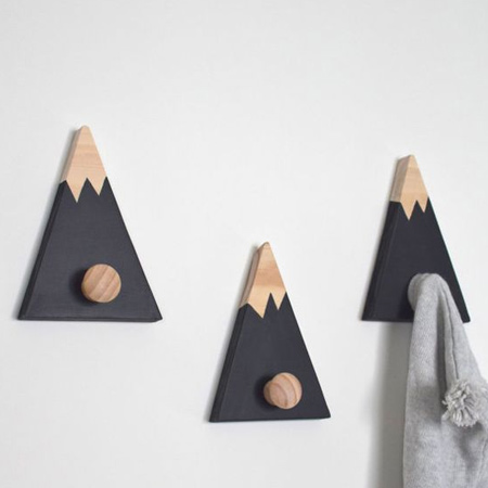 Combine small scraps, pine knobs and craft paint to make unique coat hangers for a home. Use picture hangers or keyhole brackets to mount onto the wall.