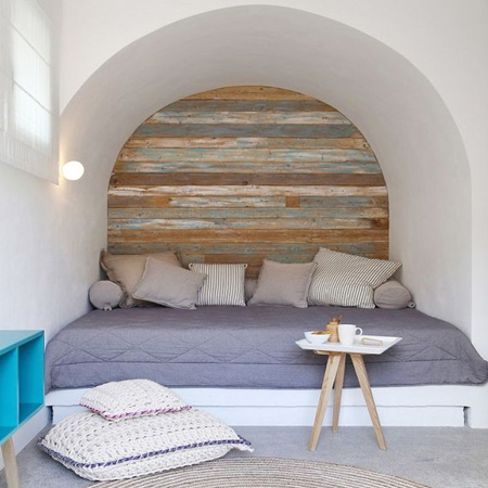 Not a new idea, reclaimed wood - or pine given a technique to make it look aged - it a wonderful way to add a feature to boring walls. Rather than fasten individual planks to walls, it's easier to mount battens (thin strips) vertically on the wall and secure planks or boards to these.