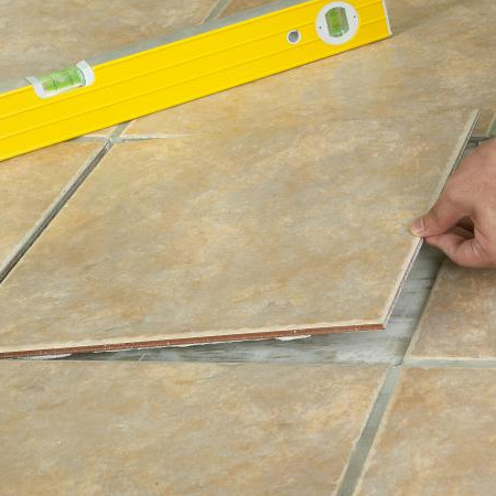 5. Mix tile adhesive according to the instructions and apply to the entire back of the replacement tile.