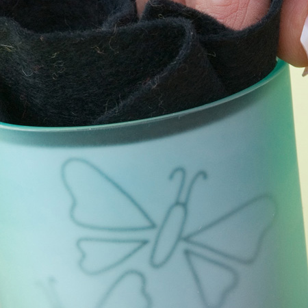 Seaglass votive with engraved butterfly design