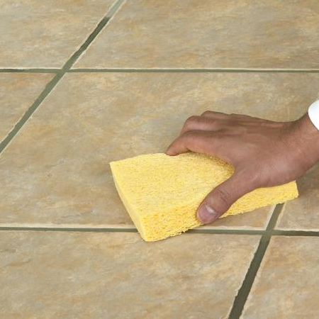 Allow time for the adhesive to dry and then apply grout.