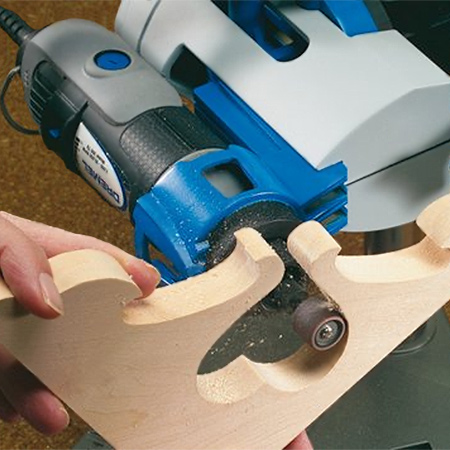 Tilt the tool holder at a 45-degree angle to allow for easy sanding of detailed items, such as pine shelf brackets