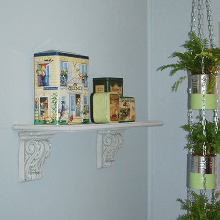 This quick and easy shelf is made using a couple of polystyrene corbels, a scrap of timber or board, and some moulding.