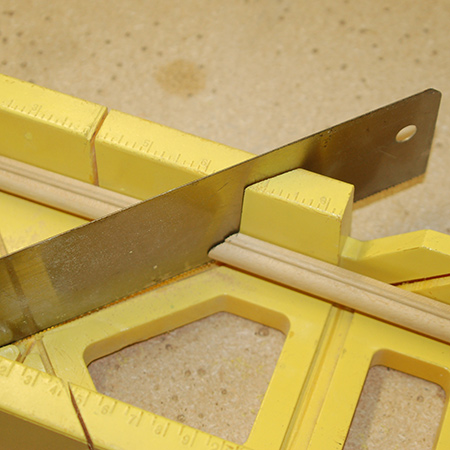 2. Use a mitre box and backsaw to cut opposing 45-degree angles.