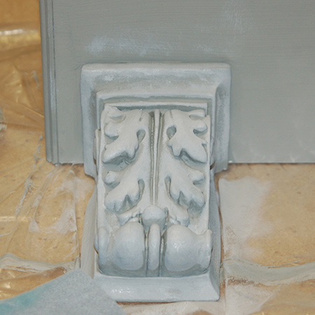 Close up of the corbel after a base coat of Rust-Oleum Chalked in Country Grey and a top coat of Aged Grey