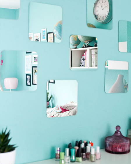 Create the illusion of space by adding a few mirror squares to blank walls