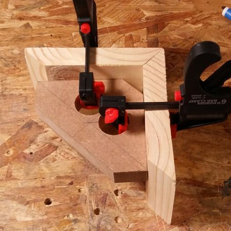 a corner jig that is easy to clamp in place and holds corners perfectly square while you wait for glue to dry!