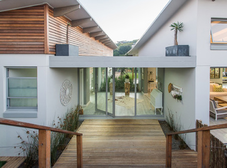 To integrate the property with its natural surrounds, stone cladding and timber decks are used extensively for entertainment areas and walkways