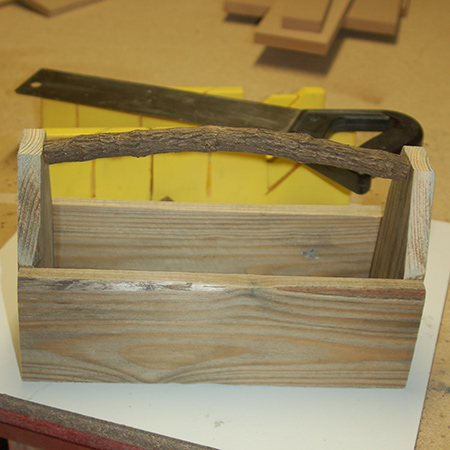 I used a tree branch using a mitre box and saw to serve as a handle. Other alternatives include a pine dowel, or to use medium-gauge wire.