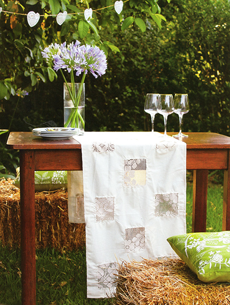 There are even more crafty ideas for using fabrics and textiles, like this table runner made from an old crochet or lace tablecloth and some leftover cotton fabric.