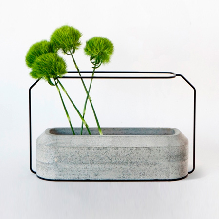 Recognised as an object d'art, the Weight Vase is designed by Decha Archjananun and uses cement as an art form. Concrete vases in 2 parts function together to bring a new perspective on the traditional flower vase.