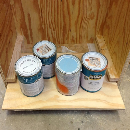 You can build the cabinet as large as you need for all your paints and adjust the height of the drawers to allow for small or large cans.