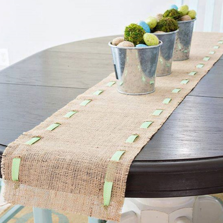 Cut a length of burlap for your dining table and trim to allow for colourful ribbon to be threaded through the fabric.