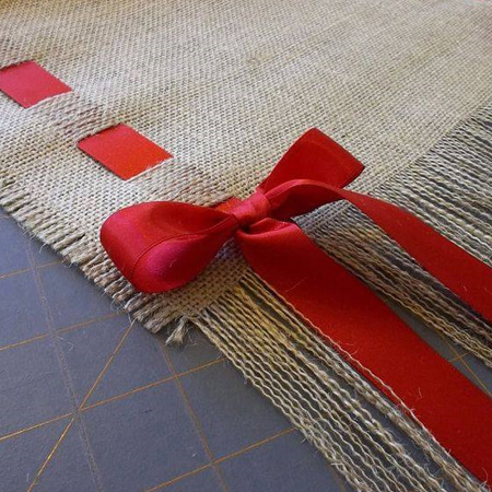 Cut a length of burlap to fit on your dining table and trim to allow for colourful ribbon to be threaded through the fabric.