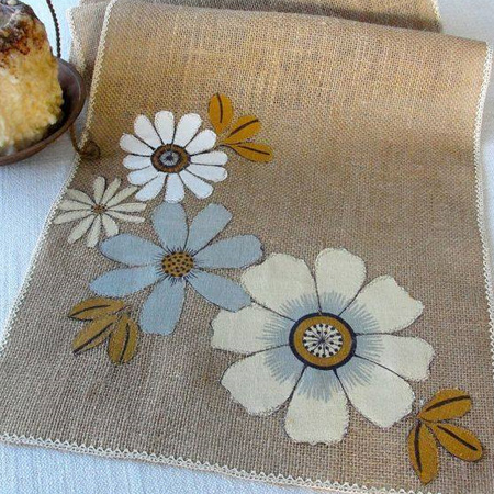 Give a new twist to burlap placemats by using a stencil and craft paint to print your own designs.