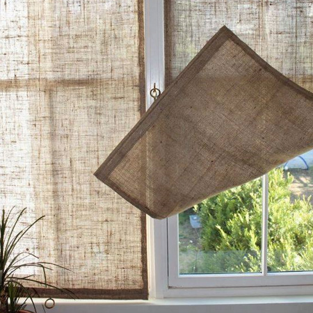 Block out the sun without blocking out too much light with burlap window panels. The coarse weave of burlap offers you privacy and shade.